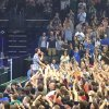 Photo -  Man of the People: Eddie Vedder communes with the crowd at Chesapeake Energy Arena on Saturday.