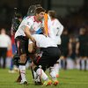 Photo - Liverpool's Steven Gerrard, left helps teammate Luis Suarez, following the end of the English Premier League soccer match between Crystal Palace and Liverpool at Selhurst Park stadium in London, Monday, May 5, 2014. The game ended in a 3-3 draw. (AP Photo/Alastair Grant)
