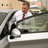 Photo - Former Fiesta Bowl executive director John Junker gets into his car outside the Sandra Day O'Connor U.S. courthouse after being sentenced in Phoenix on Thursday, March 13,  2014. Junker was sentenced to eight months in federal prison for participating in a scheme in which bowl employees made illegal campaign contributions to politicians and were reimbursed by the nonprofit bowl. (AP Photo/The Arizona Republic, Michael Schennum)  MARICOPA COUNTY OUT; MAGS OUT; NO SALES