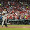 New York Yankees\' Derek Jeter prepares to bat as a steady rain falls during the first inning of a baseball game against the St. Louis Cardinals Monday, May 26, 2014, in St. Louis. (AP Photo/Jeff Roberson)