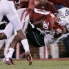 Oklahoma\'s Javon Harris (30) brings down Baylor\'s Clay Fuller (23) during the college football game between the University of Oklahoma Sooners (OU) and Baylor University Bears (BU) at Gaylord Family - Oklahoma Memorial Stadium on Saturday, Nov. 10, 2012, in Norman, Okla. Photo by Chris Landsberger, The Oklahoman