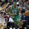 Boston Celtics\' Paul Pierce (34) dribbles the ball as New Jersey Nets\' Gerald Green (14) tries to block his path during the second quarter of an NBA basketball game in Newark, N.J., Saturday, April 14, 2012. (AP Photo/Mel Evans)