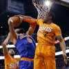 Photo - New York Knicks' Tyson Chandler (6) has his shot blocked by Phoenix Suns'  Eric Bledsoe (2) during the first half of an NBA basketball game, Friday, March 28, 2014, in Phoenix. (AP Photo/Matt York)