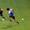 Photo - Belgium captain Vincent Kompany, left, who is recovering from an injury, and Axel Witsel take part in a training session at Estadio Manoel Barradas, the day before the World Cup round of 16 soccer match between Belgium and USA at Arena Fonte Nova in Salvador, Brazil, Monday, June 30, 2014. (AP Photo/Julio Cortez)