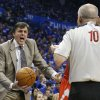 Photo - Houston Rockets head coach Kevin McHale, left, questions official Ron Garretson (10) about a call in the third quarter of Game 1 of a first-round NBA basketball playoff series against the Oklahoma City Thunder in Oklahoma City, Sunday, April 21, 2013. Oklahoma City won 120-91. (AP Photo/Sue Ogrocki)