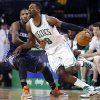 Photo - Boston Celtics' Jeff Green (8) drives past Charlotte Bobcats' Michael Kidd-Gilchrist (14) in the second quarter of an NBA basketball game in Boston, Friday, April 11, 2014. (AP Photo/Michael Dwyer)