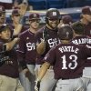 Photo - Mississippi State's Wes Rea and teammates greet Brett Pirtle at home after his three-run home run against South Carolina during the Southeastern Conference NCAA college baseball tournament on Wednesday, May 21, 2014, in Hoover, Ala. (AP Photo/Hal Yeager)