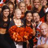 Photo - Justin Blackmon superfan Olivia Hamilton gets her picture taken with the OSU Spirit Squad after the OSU-Tulsa game. PHOTO BY JENNY RODGERS, Cavett Kids Foundation
