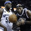 Brooklyn Nets\' Reggie Evans, right, is pressured by Memphis Grizzlies\' Zach Randolph (50) during the first half of an NBA basketball game in Memphis, Tenn., Friday, Jan. 25, 2013. (AP Photo/Danny Johnston)