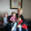 "Susan Linn from Prague, Oklahoma, sits with her adopted children in the waiting room at the J. D. McCarty Center. After moving back to Prague from Norman she continues to drive to Norman every week so that her children can receive outpatient therapy services at the McCarty Center. ""It's a small sacrifice for a great reward for my kids. I don't believe that I could find what we get here anywhere else. I get encouragement here, I don't get pity and I appreciate that,"" Linn said. Linn's children are (l-r) Jake, age three, Addey, almost two, and Luke, age five. Community Photo By: Greg Gaston Submitted By: Greg, Norman"