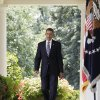 Photo - FILE - In this Aug. 2, 2011 file photo, President Barack Obama arrives to speak in the Rose Garden of the White House in Washington, after the Senate passed the debt ceiling legislation. Back in the summer of 2011, as a debt crisis loomed much like one does again today, Obama issued a clear threat to Republicans: Without an agreement to raise the nation's borrowing limit, older Americans might not get their Social Security checks. He wasn't the first to issue such a warning in the face of a debt fight between an administration and Congress. The federal government could run out of cash to pay all its bills in full as early as Feb. 15, according to one authoritative estimate, and congressional Republicans want significant spending cuts in exchange for raising the debt ceiling. Obama, forced to negotiate an increase in 2011, has vowed not to negotiate again. (AP Photo/Carolyn Kaster, File)