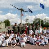 Members of 910th Air Wing Youngstown ARS US Air Force, Ohio, left to right, CAPT Alex Manolache, MAJ Jay Ference, LTC Eric Bishop, CAPT Tony Santucci, SMSGT Tom Marhulik, LTC Don Richey, pose with schoolchildren of Picauville, in front of a monument in homage to the English and American airborne and pilots, in Picauville, France. World leaders and veterans prepare to mark the 70th anniversary of the invasion this week in Normandy. (AP Photo/Claude Paris)