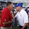 Photo -   Tampa Bay Buccaneers head coach Greg Schiano, left, and New York Giants head coach Tom Coughlin, right, talk after an NFL football game on Sunday, Sept. 16, 2012, in East Rutherford, N.J. The Giants won the game 41-34. (AP Photo/Julio Cortez)