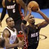 Miami\'s Chris Bosh (1) takes the ball to the hoop past Oklahoma City\'s Serge Ibaka (9) during Game 2 of the NBA Finals between the Oklahoma City Thunder and the Miami Heat at Chesapeake Energy Arena in Oklahoma City, Thursday, June 14, 2012. Photo by Nate Billings, The Oklahoman