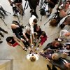 Photo - Gov. Mary Fallin, bottom center, faces microphones and cameras in the Capitol rotunda as she makes comments to the media before Tuesday's special session started. Lawmakers gathered in their respective chambers at the state Capitol Tuesday afternoon,  Sep. 3, 2013, on the first day of a special session called by Gov. Mary Fallin.   Photo  by Jim Beckel, The Oklahoman.