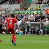 Photo - Swansea City's Wayne Routledge, right, scores a goal during their English Premier League soccer match against West Bromwich Albion at the Liberty Stadium, Swansea, Wales, Saturday, Aug. 30, 2014. (AP Photo/Nick Potts, PA Wire)     UNITED KINGDOM OUT   -   NO SALES   -   NO ARCHIVES