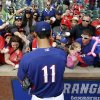Photo - Texas Rangers' Yu Darvish, of Japan, signs autographs for fans before a baseball game against the Philadelphia Phillies, Monday, March 31, 2014, in Arlington, Texas. (AP Photo/Tony Gutierrez)