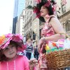 Julia Scott, 4, of Fairlawn, N.J., left, and her mother Regina Scotti, right, take part in the Easter Parade along New York\'s Fifth Avenue Sunday April 24, 2011. (AP Photo/Tina Fineberg)