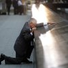 Robert Peraza, who lost his son Robert David Peraza in the attacks at the World Trade Center, pauses at his son\'s name at the North Pool of the 9/11 Memorial before the 10th anniversary ceremony at the site, Sunday Sept. 11, 2011, in New York. (AP Photo/Justin Lane, Pool)