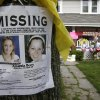 Photo - A missing poster still rests on a tree outside the home of Amanda Berry Wednesday, May 8, 2013, in Cleveland. Berry, 27, Michelle Knight, 32, and Gina DeJesus, had apparently been held captive in a house since their teens or early 20s, police said. (AP Photo/Tony Dejak)