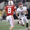Oklahoma\'s Trey Fanks (2) looks for running room past Nebraska\'s Austin Cassidy (8) during the Big 12 football championship game between the University of Oklahoma Sooners (OU) and the University of Nebraska Cornhuskers (NU) at Cowboys Stadium on Saturday, Dec. 4, 2010, in Arlington, Texas. Photo by Chris Landsberger, The Oklahoman