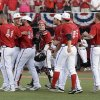 Photo - Louisville players celebrate following their 12-3 victory over Oklahoma State in the NCAA college baseball tournament Louisville regional game, Sunday, June 2, 2013, in Louisville, Ky. (AP Photo/Timothy D. Easley)