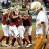 Tennessee\'s Lexi Overstreet (19) walks off the field as Oklahoma celebrates their championship during Women\'s College World Series softball game between Oklahoma and Tennessee at ASA Hall of Fame Stadium in Oklahoma City,Tuesday, June, 4, 2013. Photo by Sarah Phipps, The Oklahoman
