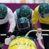 Photo - The team from Australia AUS-1, piloted by Heath Spence, start a run during the men's four-man bobsled training at the 2014 Winter Olympics, Wednesday, Feb. 19, 2014, in Krasnaya Polyana, Russia. (AP Photo/Michael Sohn)