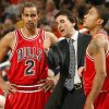Chicago Bulls head coach Vinny Del Negro, center, talks with Thabo Sefolosha, left, of Switzerland, and Derrick Rose in the first quarter against the Phoenix during an NBA basketball game on Saturday, Jan. 31, 2009, in Phoenix. (AP Photo/Rick Scuteri) ORG XMIT: AZRS104