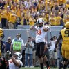 Oklahoma State\'s Ben Grogan (19) reacts after missing a tying field goal late in the fourth quarter of a college football game between the Oklahoma State University and West Virginia University on Mountaineer Field at Milan Puskar Stadium in Morgantown, W. Va., Saturday, Sept. 28, 2013. Photo by Sarah Phipps, The Oklahoman