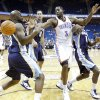 OKC\'s D.J. White (3) battles under the basket with Memphis\' Damien Wilkins (3) and DeMarre Carroll (1) during the second half of the preseason NBA basketball game between the Oklahoma City Thunder and the Memphis Grizzlies on Tuesday, Oct. 12, 2010, in Tulsa, Okla. Photo by Chris Landsberger, The Oklahoman
