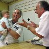 John Sacco Sr. hands his 6-month-old grandson, Jack Russo, to Pete Canu, a customer in Sacco\'s Elizabeth, N.J., butcher shop, Thursday, June 20, 2013. Canu says he liked the realism and human flaws of actor James Gandolfini\'s Tony Soprano character, but Sacco said,