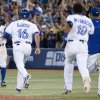 Toronto Blue Jays\' Rajai Davis, left, turns to celebrate with on rushing teammates after hitting a game-winning single during the ninth inning against Baltimore Orioles baseball game in Toronto on Friday June 21, 2013. (AP Photo/The Canadian Press, Chris Young)