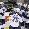 Photo - St. Louis Blues left wing Magnus Paajarvi (56), of Sweden, celebrates with teammates after scoring against the Nashville Predators in the second period of an NHL hockey game Thursday, March 6, 2014, in Nashville, Tenn. (AP Photo/Mark Humphrey)