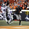Oklahoma State\'s Joseph Randle (1) scores the game-winning touchdown in front of Kansas State\'s Emmanuel Lamur (23), David Garrett (27) and Allen Chapman (3) during a college football game between the Oklahoma State University Cowboys (OSU) and the Kansas State University Wildcats (KSU) at Boone Pickens Stadium in Stillwater, Okla., Saturday, Nov. 5, 2011. Photo by Sarah Phipps, The Oklahoman