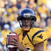 West Virginia quarterback Geno Smith (12) looks to pass during the second quarter of their NCAA college football game against Kansas in Morgantown, W.Va., on Saturday, Dec. 1, 2012. (AP Photo/Christopher Jackson)