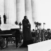 Photo - FILE - This April 9, 1939 file photo shows singer Marian Anderson performing on the steps of Washington's Lincoln Memorial on Easter Sunday after she had been refused permission to perform in Washington's Constitution Hall by the hall's owners, the Daughters of the American Revolution. For the first time, Marian Anderson's orange-and-black blouse and skirt ensemble that she wore during her historic performance on the Lincoln Memorial steps 75 years ago will go on display at the Smithsonian. Anderson was a groundbreaking opera singer but was kept out of Washington's Constitution Hall because she was black, and Eleanor Roosevelt invited her to perform at the Lincoln Memorial instead. The concert attire is part of a collection being donated to the National Museum of African American History and Culture by a member of Anderson's extended family to mark the anniversary of Anderson's concert on Wednesday. It will be displayed beginning Tuesday and will remain on view until September.  (AP Photo, File)