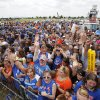 Fans cheer as the Thunder leave a welcome home rally for the Oklahoma City Thunder in a field at Will Rogers World Airport after the team\'s loss to the Miami Heat in the NBA Finals, Friday, June 22, 2012. Photo by Nate Billings, The Oklahoman