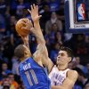 Oklahoma City\'s Steven Adams (12) defends on Dallas\' Monta Ellis (11) during the NBA basketball game between the Oklahoma City Thunder and the Dallas Mavericks at Chesapeake Energy Arena in Oklahoma City, Okla. on Wednesday, Nov. 6, 2013. Photo by Chris Landsberger, The Oklahoman