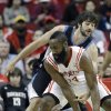 Minnesota Timberwolves\' Ricky Rubio, rear, of Spain, tries to knock the ball away from Houston Rockets\' James Harden (13) in the first half of an NBA basketball game Friday, March 15, 2013, in Houston. (AP Photo/Pat Sullivan)