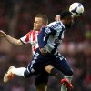 Photo - Sunderland's Seb Larsson, left, vies for the ball with West Bromwich Albion's Stephane Sessegnon, right, during their English Premier League soccer match at the Stadium of Light, Sunderland, England, Wednesday, May 7, 2014. (AP Photo/Scott Heppell)