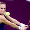 Photo - Magdalena Rybarikova of Slovakia returns the ball to Francesca Schiavone of Italy  during the second day of the WTA Qatar Ladies Open in Doha, Qatar, Tuesday, Feb. 11, 2014. (AP Photo/Osama Faisal)