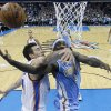 Denver Nuggets guard Ty Lawson (3) is fouled by Oklahoma City Thunder forward Nick Collison (4) as he shoots in the second quarter of an NBA basketball game in Oklahoma City, Tuesday, March 19, 2013. Denver won 114-104. (AP Photo/Sue Ogrocki)