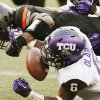 Oklahoma State\'s Blake Jackson (18) fumbles the ball as TCU\'s Elisha Olabode (6) defends in the fourth quarter during a college football game between Oklahoma State University (OSU) and Texas Christian University (TCU) at Boone Pickens Stadium in Stillwater, Okla., Saturday, Oct. 27, 2012. OSU recovered the fumble. Photo by Nate Billings, The Oklahoman