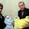 In this photo provided by Turkish Prime Minister\'s Press Service, Turkish Prime Minister Recep Tayyip Erdogan, and his wife Emine Erdogan hold newly born babies during a visit to a Syrian refugee camp in Sanliurfa, Turkey, Sunday, Dec. 30, 2012. Erdogan repeated a call on Syrian President Bashar Assad to step down. (AP Photo/Kayhan Ozer)