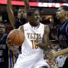 Photo -   Texas' Jonathan Holmes (10) is pressured by Coppin State's Charles Ieans (34) as he drives into the lane during the first half of an NCAA college basketball game, Monday, Nov. 12, 2012, in Austin, Texas. (AP Photo/Eric Gay)