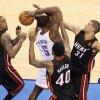Oklahoma City\'s Kendrick Perkins (5) is trapped by Miami\'s Mario Chalmers (15), Udonis Haslem (40), and Shane Battier (31) during Game 2 of the NBA Finals between the Oklahoma City Thunder and the Miami Heat at Chesapeake Energy Arena in Oklahoma City, Thursday, June 14, 2012. Photo by Nate Billings, The Oklahoman