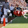 OU\'s Ryan Broyles scores a touchdown in front of Utah State\'s Chris Randle during the first half of the college football game between the University of Oklahoma Sooners (OU) and Utah State University Aggies (USU) at the Gaylord Family-Oklahoma Memorial Stadium on Saturday, Sept. 4, 2010, in Norman, Okla. Photo by Bryan Terry, The Oklahoman
