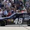 Photo -   Jimmie Johnson (48) drives to his garage after qualifying for the NASCAR Sprint Cup Series auto race at Chicagoland Speedway in Joliet, Ill., Saturday, Sept. 15, 2012. Johnson won the pole with a lap of 29.530 second, 182.865 mph. (AP Photo/Nam Y. Huh)