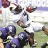 Photo - Louisiana Monroe running back Jyruss Edwards (7) is stopped by TCU tight end Corey Fuller (86) and linebacker Deryck Gildon (36) during the first half of an NCAA college football game in Fort Worth, Texas, Saturday, Sept. 17, 2011. (AP Photo/LM Otero)